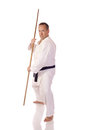 Man karate gi bo staff his hands Stock Photo