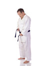 Man karate gi fastening his black belt Stock Photography