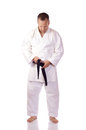 Man karate gi fastening his black belt Stock Image