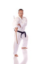 Man karate gi holding bo staff Royalty Free Stock Photos