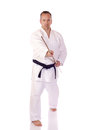 Man karate gi holding bo staff Stock Photo