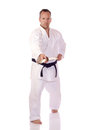 Man karate gi holding boken Stock Images