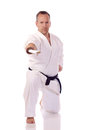 Man karate gi holding boken Stock Photos