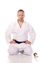 Man karate gi holding boken seiza position Royalty Free Stock Photos