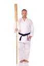 Man karate gi holding kai Stock Photography