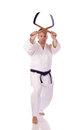 Man karate gi holding pair kama Stock Photo