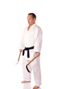 Man karate gi holding pair kama Royalty Free Stock Photo