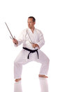 Man karate gi holding pair sai Royalty Free Stock Photo