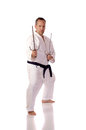 Man karate gi holding pair sai Royalty Free Stock Images