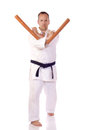 Man karate gi holding pair tonfa Royalty Free Stock Photos