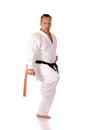 Man karate gi holding pair tonfa Stock Image