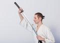 A man with katana on Iaido practice