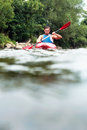 Man kayaking surface view of a young down a river Stock Images