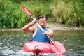 Man kayaking a young down a river Royalty Free Stock Photo