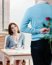 Man keeps red rose behind his back Stock Photo