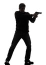 Man killer policeman aiming gun standing silhouette one studio white background Stock Image