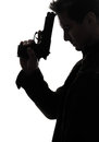Man killer policeman holding gun portrait silhouette one studio white background Stock Photography
