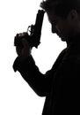 Man killer policeman holding gun portrait silhouette Royalty Free Stock Photo