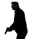 Man killer policeman holding gun silhouette Royalty Free Stock Photo