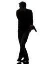 Man killer policeman holding gun walking silhouette one studio white background Stock Images
