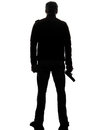 Man killer policeman holding gun walking silhouette one studio white background Stock Photos