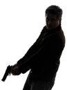 Man killer policeman holding gun walking silhouette Royalty Free Stock Photo