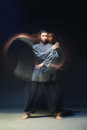 Man in kimono excercising martial arts full length portrait of on black bacground with multiexposition Stock Photo