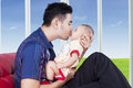 Man kiss his child near the window Royalty Free Stock Photo