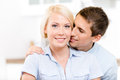 Man kisses blonde girl the cheek of smiley Royalty Free Stock Photo