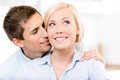 Man kisses blonde woman the cheek of smiley Royalty Free Stock Image