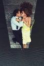 Man kisses a lady lying on the bridge Royalty Free Stock Photo