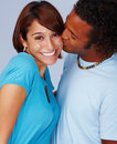 Man kissing his smiling girlfriend Royalty Free Stock Image
