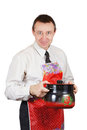 Man in a kitchen apron holds a pan Royalty Free Stock Photo