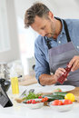 Man in kitchen preparing meal Royalty Free Stock Photo