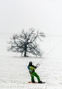 Man kite skiing on snow in wind Royalty Free Stock Photos