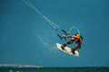 Man Kitesurfing in blue sea Royalty Free Stock Photo