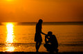 Man knees ask woman to marry on the beach love concept Royalty Free Stock Photos