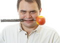 Man with knife and an apple mature holds in mouth is isolated on white background Royalty Free Stock Photography