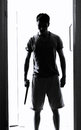 Man with knife a standing in doorway staring Royalty Free Stock Photography
