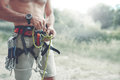 A man Knots a knot on a climbing harness Royalty Free Stock Photo
