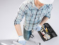 Man with ladder toolkit and spanner architect home renovation concept Royalty Free Stock Photo