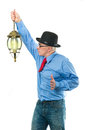 Man with lamp attractive a lantern in his hand Stock Images