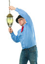 Man with lamp attractive a lantern in his hands Royalty Free Stock Image