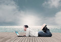 Man with laptop asian using on the beach dramatic look Royalty Free Stock Photography