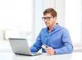Man with laptop and credit card at home business online banking internet shopping concept smiling Stock Image