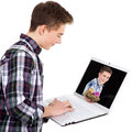Man with laptop and easter eggs Royalty Free Stock Photo