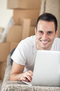 Man with laptop in new home Royalty Free Stock Photo