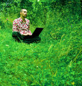 Man with laptop outdoors Stock Images