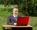 Man with laptop working outdoors Stock Photos