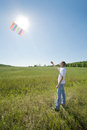 Man launch kite in field Royalty Free Stock Photography